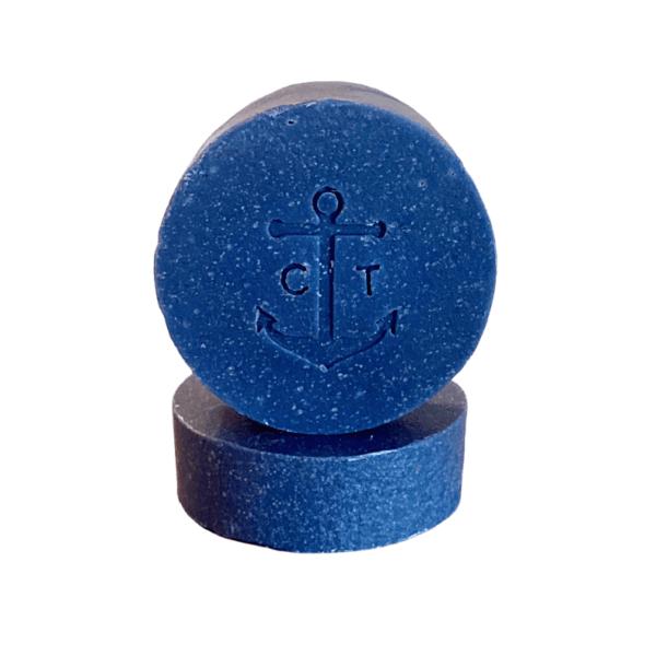 Blue circular handmade CapTen shampoo bar